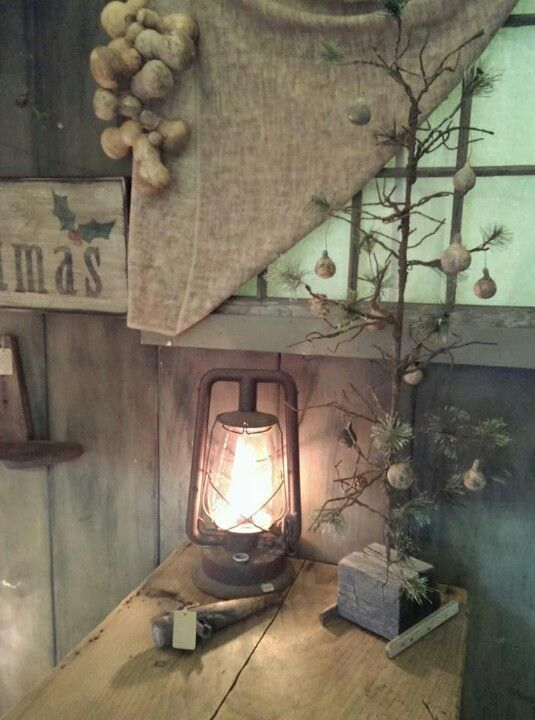 Old washed burlap curtain, lantern & feather tree with tiny gourds...ahhh!