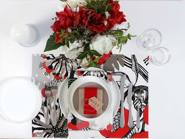 Festive table setting using red felt and Papaija Red Vallila fabric