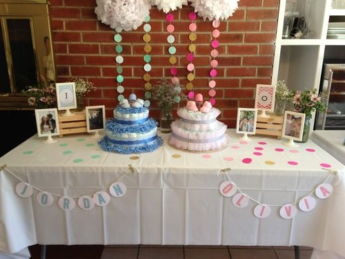 DIY decoration idea for a joint baby shower or a baby shower for boy + girl twins using bunting, poms, and circle cut out. Simple and pretty! #ohbaby