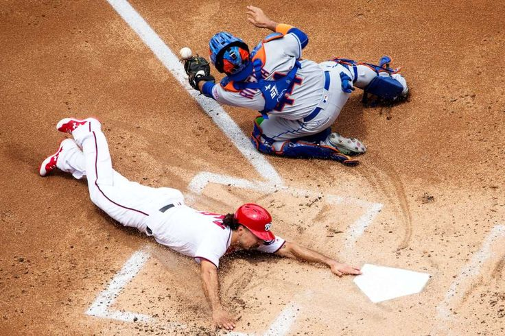 BEATING THE TAG:    Washington Nationals third baseman Anthony Rendon (6) slides home for the third homer in the first inning during a MLB National League game between the Washington Nationals and the New York Mets on April 30, at Nationals Park, in Washington DC.