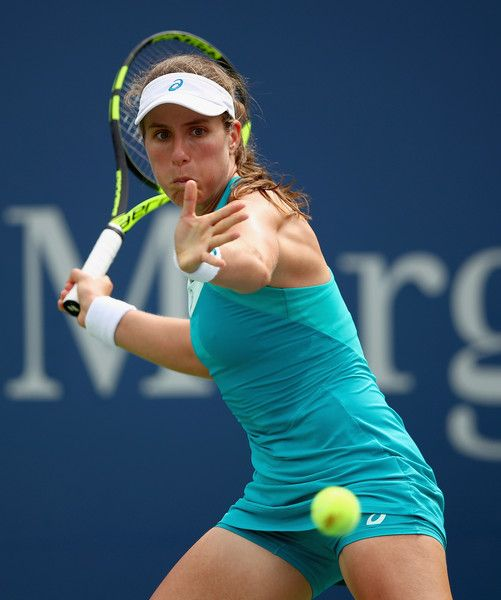 Johanna Konta of Great Britain returns a shot during her first round Women's Singles match against Aleksandra Krunic of Serbia & Montenegro on Day One of the 2017 US Open at the USTA Billie Jean King National Tennis Center on August 28, 2017 in the Flushing neighborhood of the Queens borough of New York City.