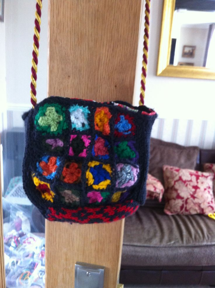 Made small pouch for my iPhone and lipstick. (Never any pockets when you wear a dress!) started with mini granny squares, added a knitted mosaic panel, then lined with Russian Doll fabric. A bit of Bohemian chic I thought!