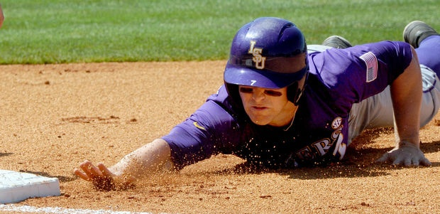 LSU's Mark Laird reaches for first base to avoid the pick-off attempt by Alabama in the first inning of a SEC Baseball Tournament elimination game at the Hoover Metropolitan Stadium in Hoover, Ala., Friday, May 24, 2013. LSU won 3-2.