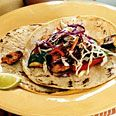 Spice-Rubbed Chicken and Vegetable Tacos with Cilantro Slaw and Chipotle Cream.  Made these tons of times.  Very easy to feed a big crowd