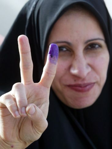 """Iraqi Woman Holds Up Her Purple Finger, Indicating She Has Just Voted in Southern Iraq""=>"