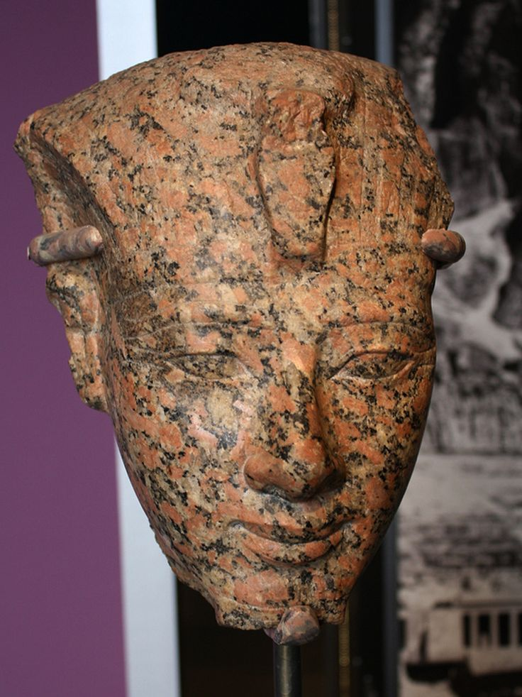 https://flic.kr/p/8aUcuB | An Egyptian New Kingdom Red Granite Face of Amunhotep II | Red granite, New Kingdom, Dynasty XVIII, ca. 1426-1400 B.C.E.  12 5/16 x 8 3/8 in. (31.3 x 21.2 cm)  The faces on most statues of Amunhotep II differ slightly from those of his two immediate predecessors. Compared with the sculptures of Thutmose III and Hatshepsut exhibited nearby, for example, this statue's face is a little longer, the eyes somewhat narrower, the brows a bit straighter, the nose slightly…