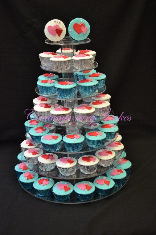 Cupcake tower of interlocking hearts.