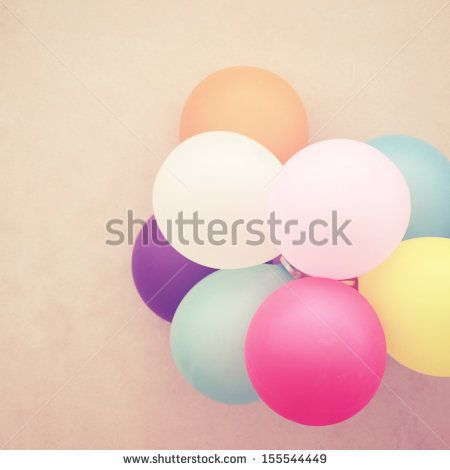 Colorful festive balloons on wall with retro filter effect by happydancing, via Shutterstock