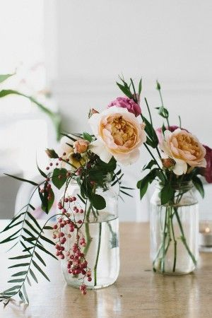 Gorgeous small flower arrangements in assorted jars and bottles. Perfect for weddings, Easter, Mother's Day brunch.