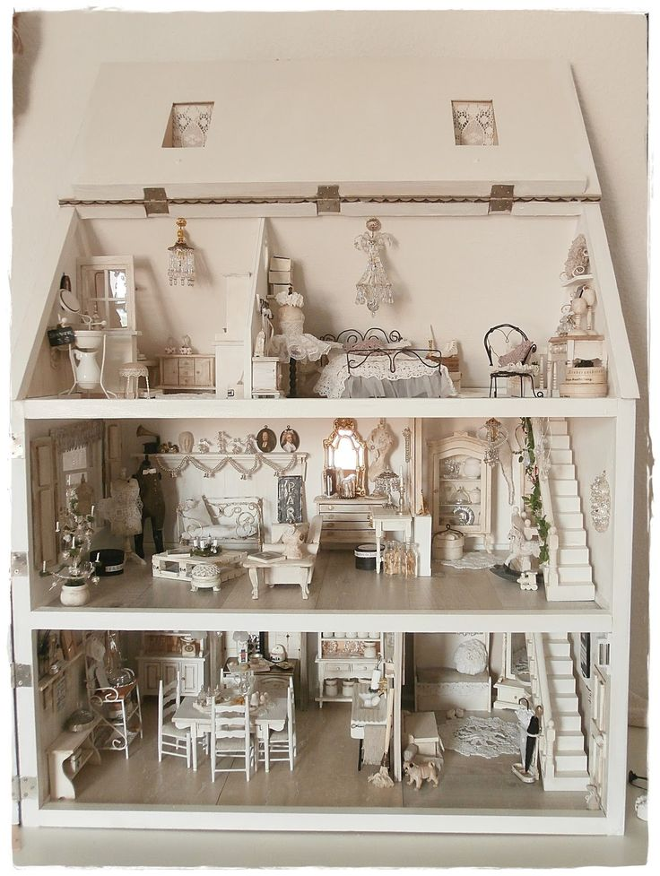An All White Neutral Doll House Done Up For Christmas