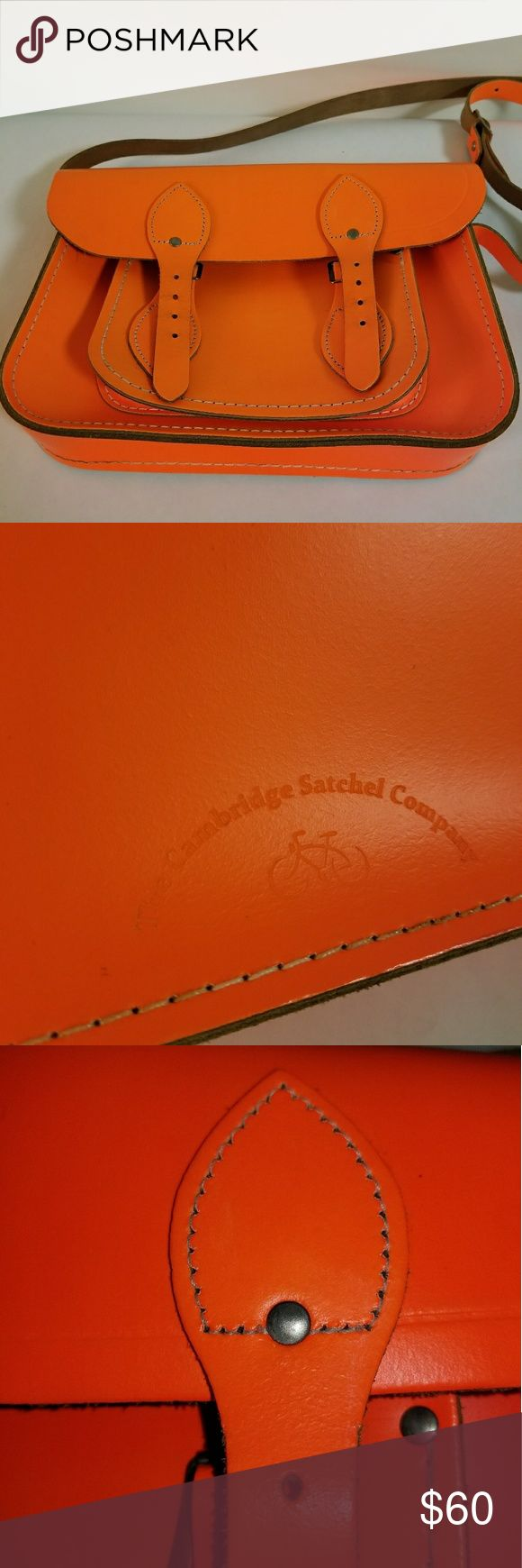 "Cambridge Satchel Company Fluro Orange Classic The Cambridge Satchel Company's Classic Leather Satchel in size small (11"") in Fluoro Orange.  Can be worn messenger style or crossbody, with an adjustable strap (approx 25"" strap drop) with buckle enclosures on the flap.  Lovingly used and in great pre-loved condition. There's a very faint stain on top of the bag (barely noticeable- see pic)  In a now discontinued, vibrant color called ""Fluoro Orange"", its very fashionable and sold out…"