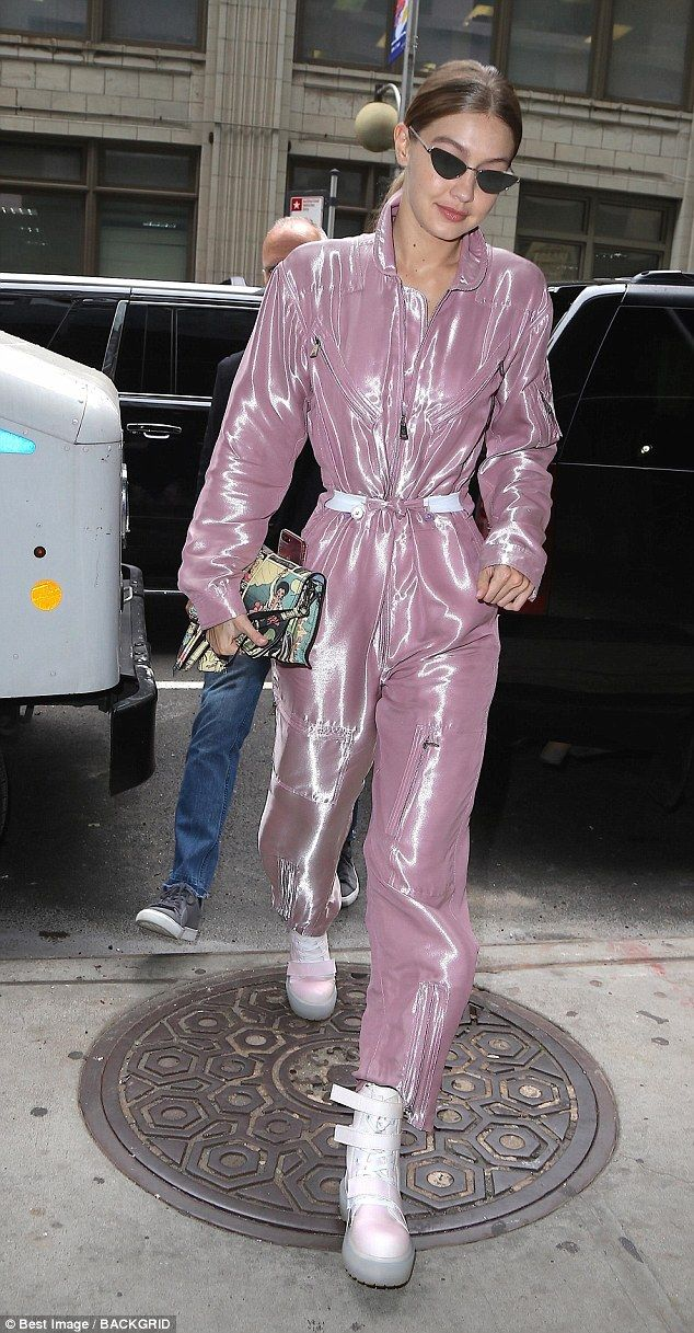387ffbb29951 Gigi Hadid makes futuristic style statement in shiny pink jumpsuit and  platforms while out in NYC