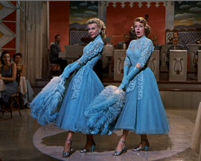 "Vera-Ellen and Rosemary Clooney in 1954 ""White Christmas"". Wearing Edith Head designs."