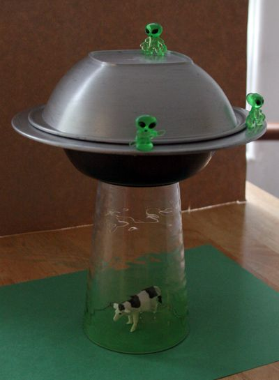 Yay!  A tutorial for MAKING the alien abduction lamp from dollar store supplies.  WAY cheaper than other options and so fun!