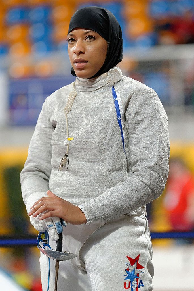 Ibtihaj Muhammad is an American sabre fencer, and a member of the United States fencing team. She is best known for being the first Muslim American woman to wear a hijab while competing for the United States in the Olympics. In individual sabre at the 2016 Summer Olympics, she won her first qualifying round bout, and was defeated in the second round by Cécilia Berder of France. She earned the bronze medal as part of Team USA in the Team Sabre, becoming the first female Muslim-American…