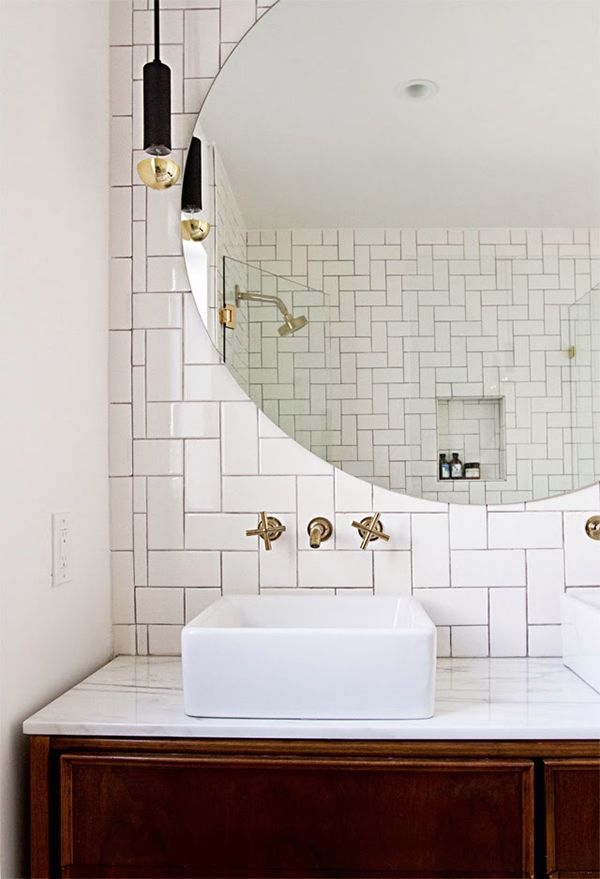 chic tile bath, great porcelain sink and gold tips with a great light fixture and a huge round mirror!