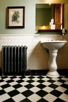 I love these bevelled metro tiles and victorian style black & white tiles.    Like the radiator