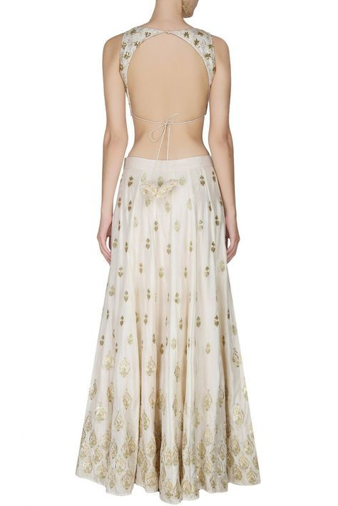 This set features an off white lehenga in silk base with gold gota and sequins motifs all over the front and back. It has a can-can underlayer. It comes along with a matching sleeveless blouse with go