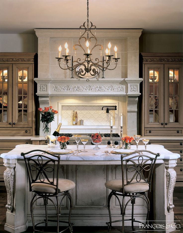 The Trianon is a grand range hood inspired by the palace of Versailles.