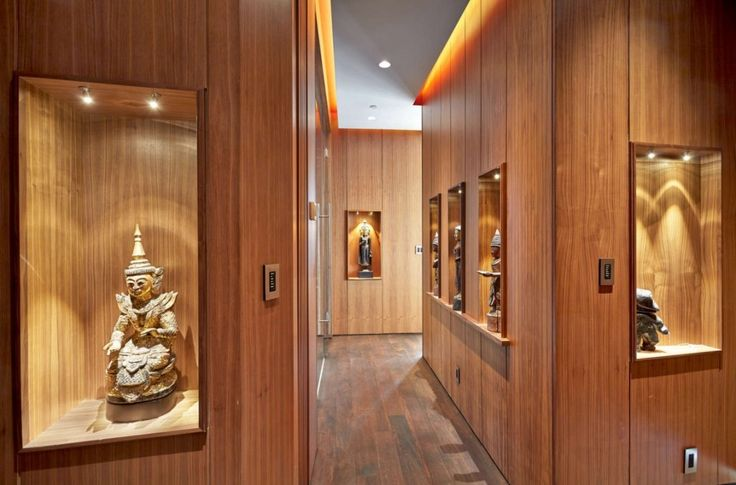 Penthouse: Classy Fichman Penthouse Interior Design In Toronto Designed By RegionalArchitects, Awesome Fichman Penthouse Hallway Interior Design By RegionalArchitects with Stunning Asian Art and Religious Sculptures Displayed on Built-in Wooden Wall Shelves