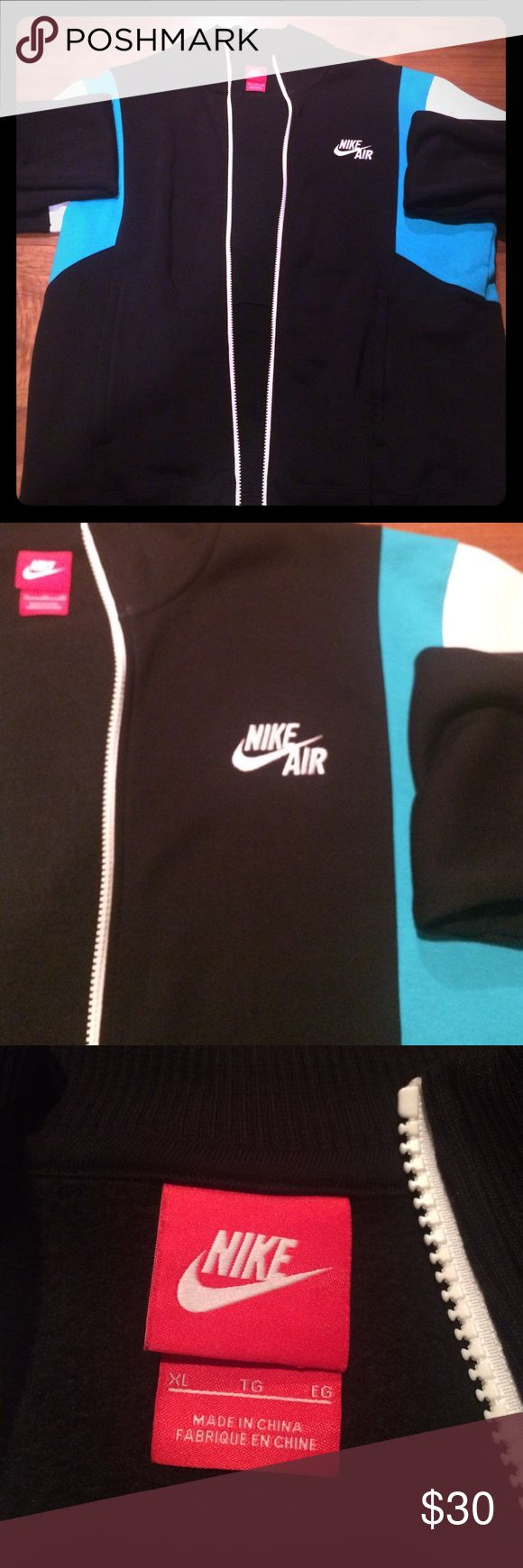 Nike Air Black/White/Blue Jacket Black/White/Blue authentic Nike Air jacket, slightly worn but in great condition! Size Men's XL, the perfect Christmas gift for any baller out there in your life! Nike Jackets & Coats Lightweight & Shirt Jackets