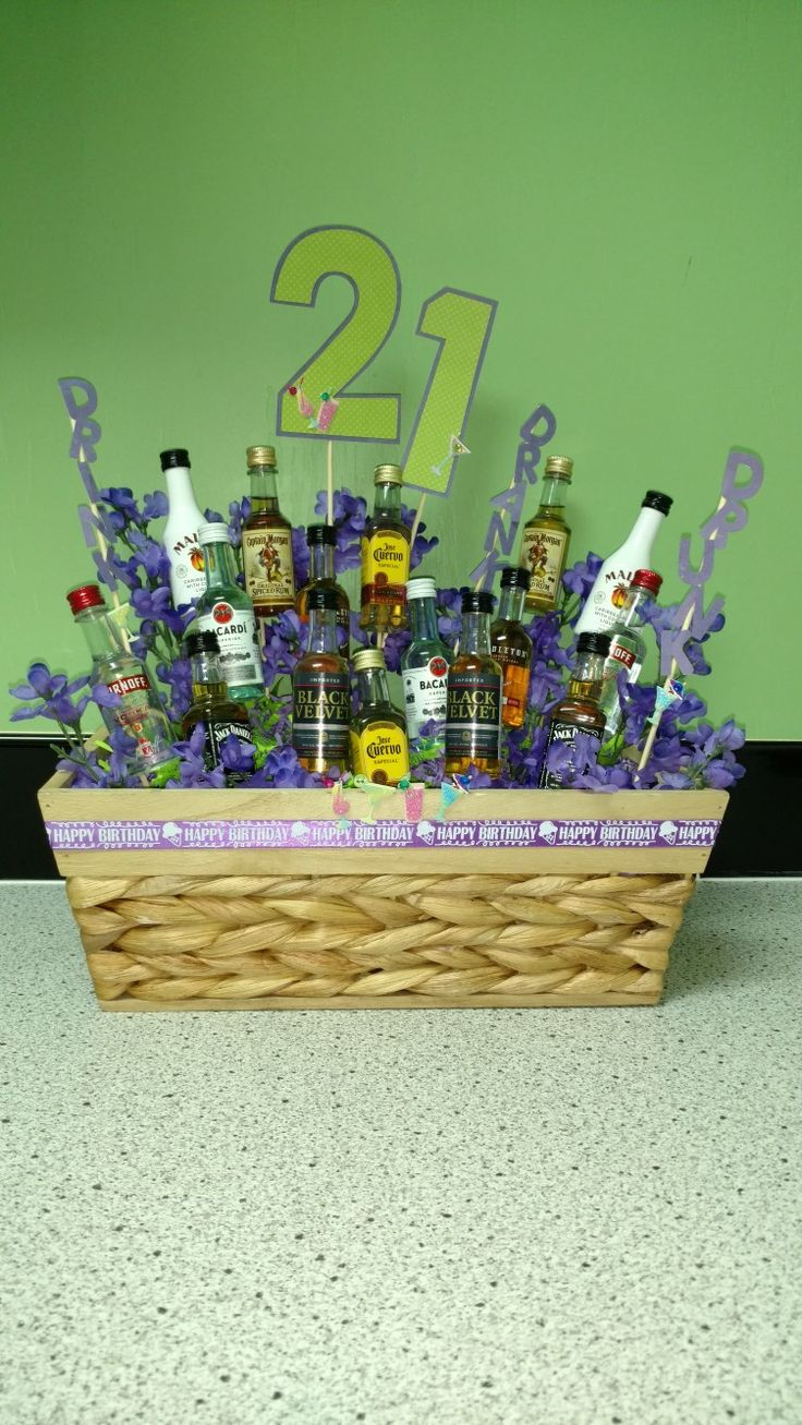 21st birthday gift. Mini alcohol bottles hot-glued to bamboo skewers. Letters and numbers cut with Cricut (21, Drink Drank Drunk). Purple happy birthday ribbon, floral foam, basket fill from Dollar Tree. Jolee's Boutique Drink Repeats stickers.