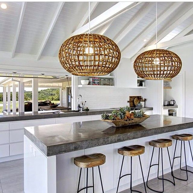 Love the Kitchen space at @thegrovebyronbay - fav rattan pendants and concrete benchtops. Love those exposed beams too! #thedesignhunter #holidayhouse #white #whiteonwhite #pendantlight #concrete #exposedbeams #sevillestools #beachy #design #interiors #kitchen #kitchendesign