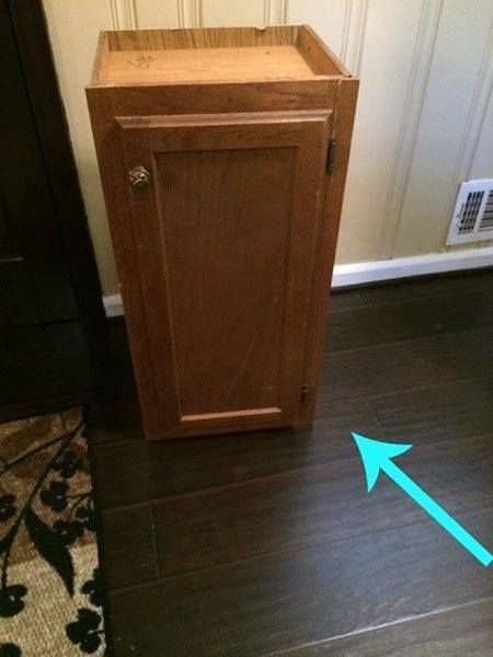 She places a kitchen wall cabinet by her front door. The reason? This entryway storage idea is genius!