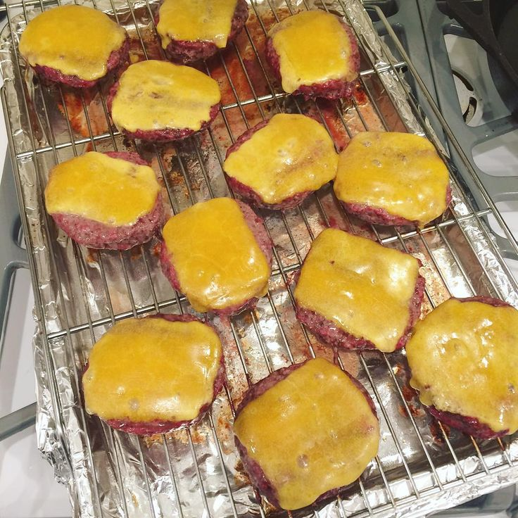 Oven roasting is the only way to quickly cook burgers for a crowd. I think it's even easier than grilling.  No flipping, no putting them on one at a time, no watching a flame. Put the patties on an oiled rack over a baking sheet (I cover with foil for easy cleanup), and pop in the oven. 475 (or 450 convection) for 10 minutes and they will be perfectly medium / medium rare. If you're doing cheese, lay the slices on and pop back in for 1 more minute. Easy dinner! These were preformed patties…