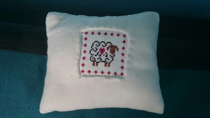 Stitched pillow (sheep cross stitch)