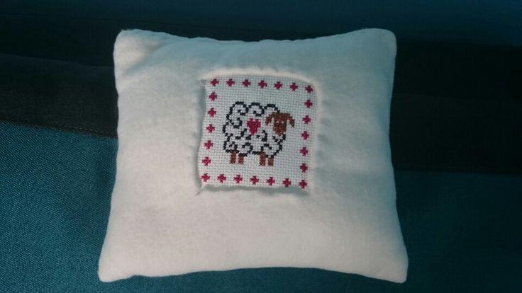 Stitched pillow (sheep cross stitch)