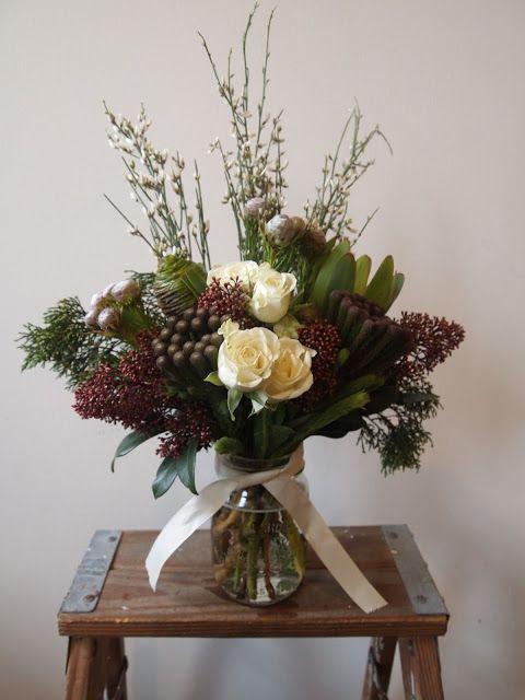 cream spray roses, acorn and honeycomb leucadendrons, leucadendron rosette, berzelia, genestra, skimmia