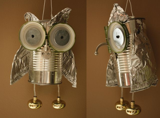 "I made this owl from an aluminum can, some Chipotle foil lids, a couple of jar lids, and household metal bits and pieces.  I used a drill to make the holes, and twisty ties to connect everything--sometimes, like for the eyes, I made a knot, where as the wings are ""sewn"" in two places with some telephone wire."