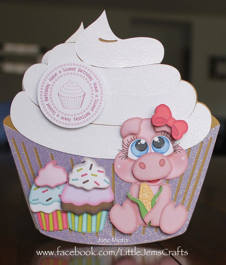 I made this card for Esther the Wonder Pig, she loves cupcakes!! :D The cupcake is a free svg file from http://www.birdscards.com/cupcakes/ and the pig and little cupcakes are from www.kadoodlebugdesigns.com  the sentiment is also a free digi stamp from Birds cards http://www.birdscards.com/a-sweet-birthday/