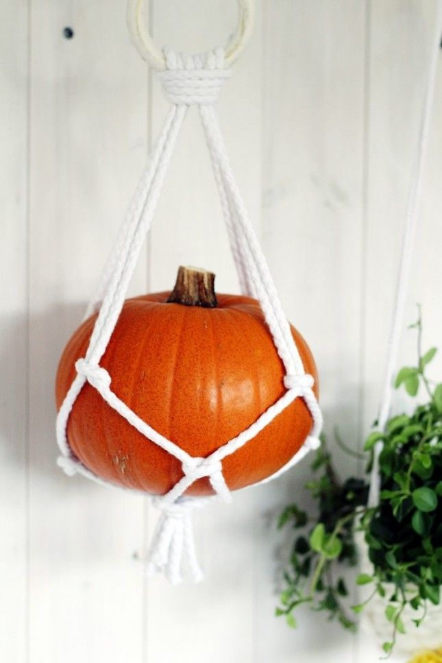Go vertical with your pumpkin decor with this hanging macrame look.