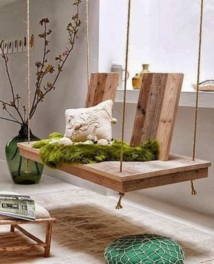 a Wooden swing in a room