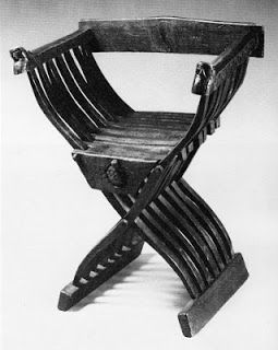 One of Two Savonarola chairs from the Museum fur Angewandte Kunst, Koln, Germany: walnut, with oak feet rail and apple backrest. Height  84 cm, width 68 cm, depth 52 cm, seating height 50 cm.  Switzerland, mid 15th century.  The front part of the seating is larger and covers the triangle between the joints. More colour photos of this chair are found in another post Medieval furniture from Koln. Images from museum catalogue MAK Koln.
