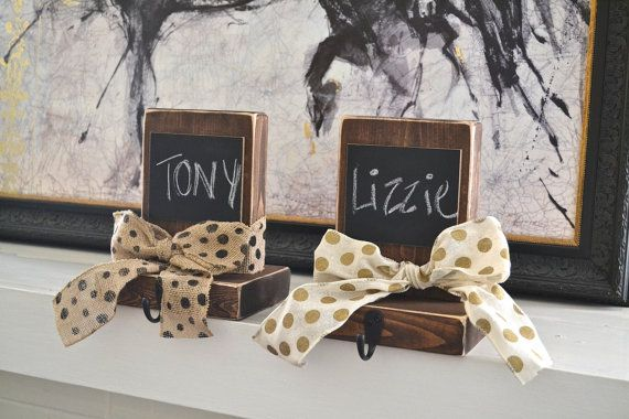 These rustic stocking hangers are perfect for your Christmas mantle. Each has a chalkboard plaque (both traditional chalk and chalk markers are