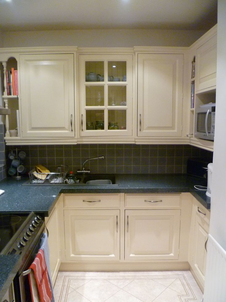 A cottage style pine kitchen brought upto date and hand painted with Dulux eggshell and sleek nickel handles