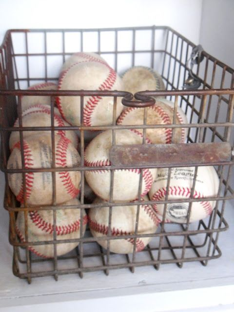 Baseballs in a vintage locker basket...or a wire basket from HomeGoods.....maybe a good idea for game ball collection Braxton!