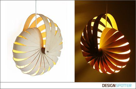 Based on a nautilus sea shell, the kit-set Nautilus hanging lamp shade uses an industrial sheet material in an innovative way to create a complex organic form. When the lamp is switched on the warm light penetrates the layers of wood to make it glow. Light pours through the spaces between the wood and creates a pattern on surrounding surfaces. The Nautilus lamp can be easily assembled in minutes from its flat packed state to create a stunning illuminated lamp shade.
