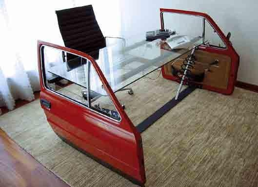 Car doors recycled as parts of an unusual desk that recreate the feel of being in a car. Great desk for people who love the feel of the road!