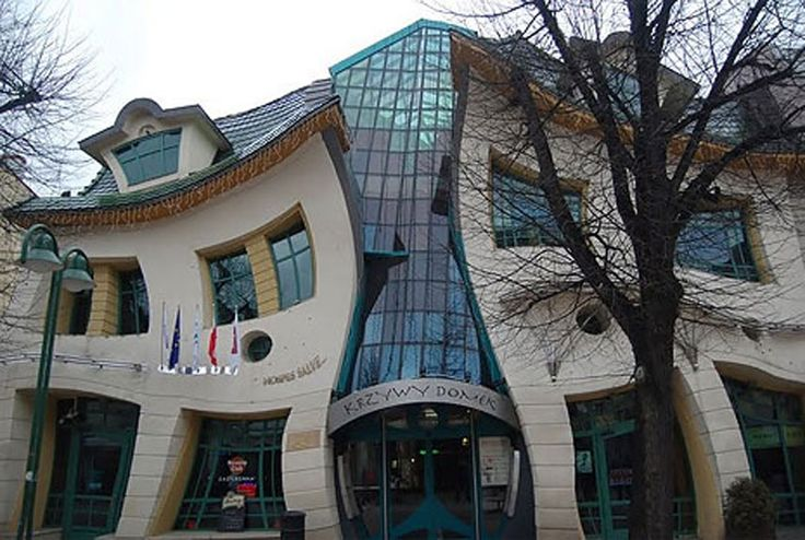 City: Sopot, Poland Background: The Crooked House is located in a shopping center. Built in 2003, the house is used for commercial purposes. How It's Strange: Drawings from a children's books illustrator, Jan Marcin Szancer, partially inspired the building's wavy look, which fits snugly between neighboring buildings and looks as though it's sagging in place. The building's roof is meant to create the illusion of dragon scales. - PopularMechanics.com