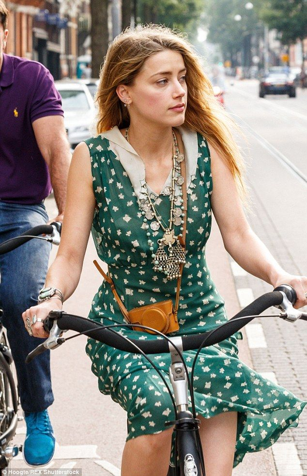 When in Amsterdam! Amber Heard spent a relaxing day in the Dutch city as she meandered thr...