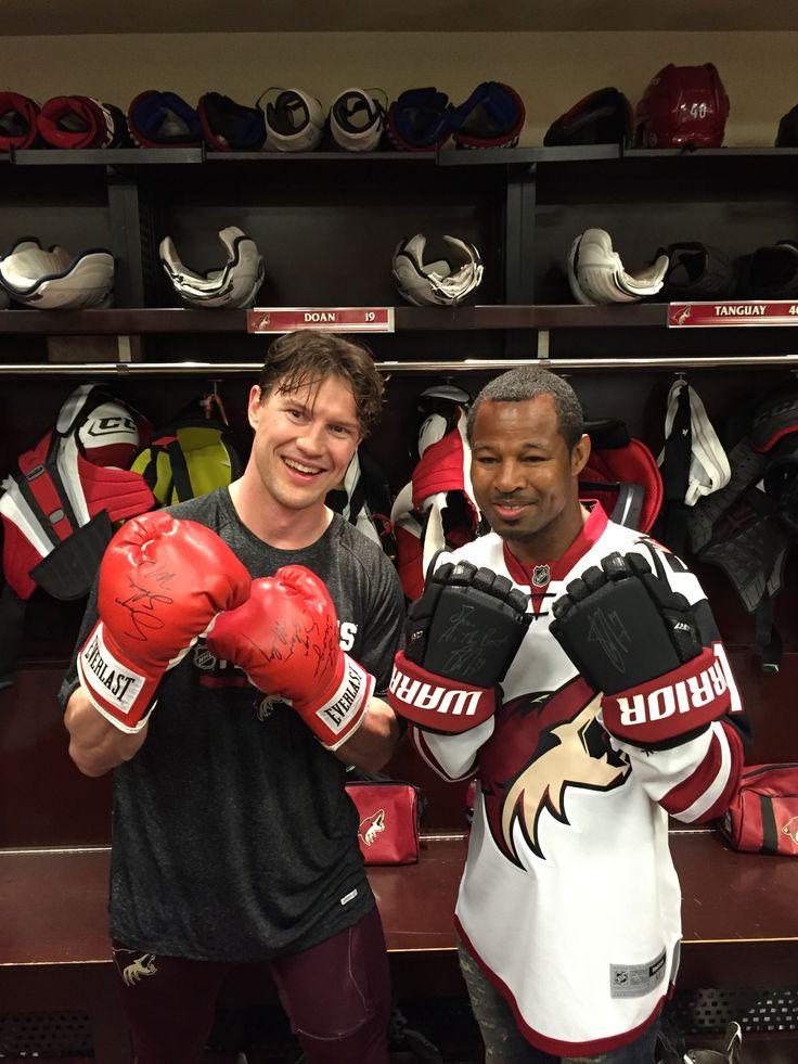 "Shane Doan and ""Sugar"" Shane Mosley trading mitts in the locker room"