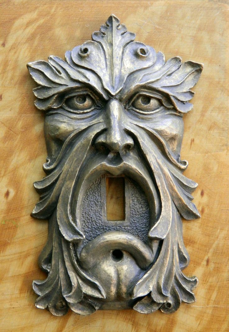 """Looking for vintage hardware? How about a """"Green Man light Switch plate"""" or """"Green Man Door bell"""", I created these years ago, they were never released...until now! Cold cast in Vintage Bronze, Aged Copper or blackened Iron. This is a new production run, limited to 100 pieces!  I've made this """"Green Man Light Switch plate"""" in a vintage hardware style, to look as if it came from a grand old house...so it has a bit of that Hollywood Gothic feel to him."""