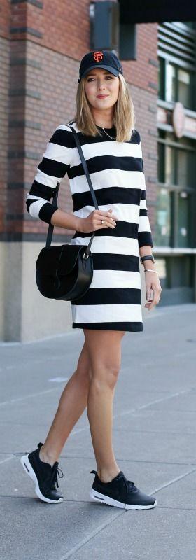 What to wear to a baseball game! {black and white striped t-shirt dress, black nike sneakers, black crossbody bag + baseball hat}