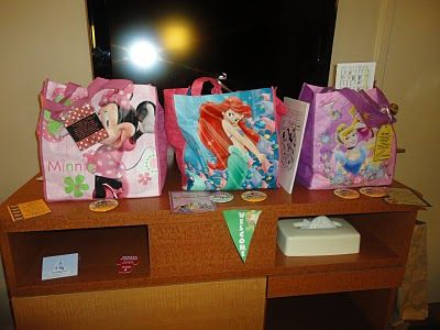 our 'welcome' gift bags when we were at Disney World. I packed them with things for the trip I had been collecting and then snuck them out so they would think they were from Mickey.