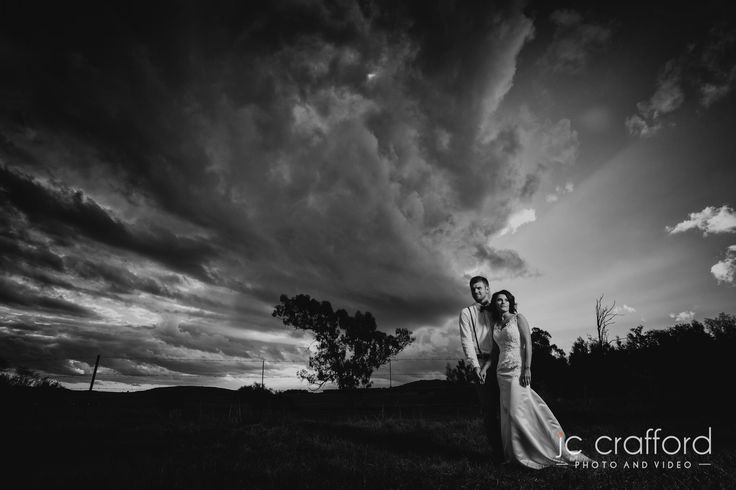We nearly didn't have a photo shoot.  It cleared up during the ceremony, and left us with this beautiful clouds.