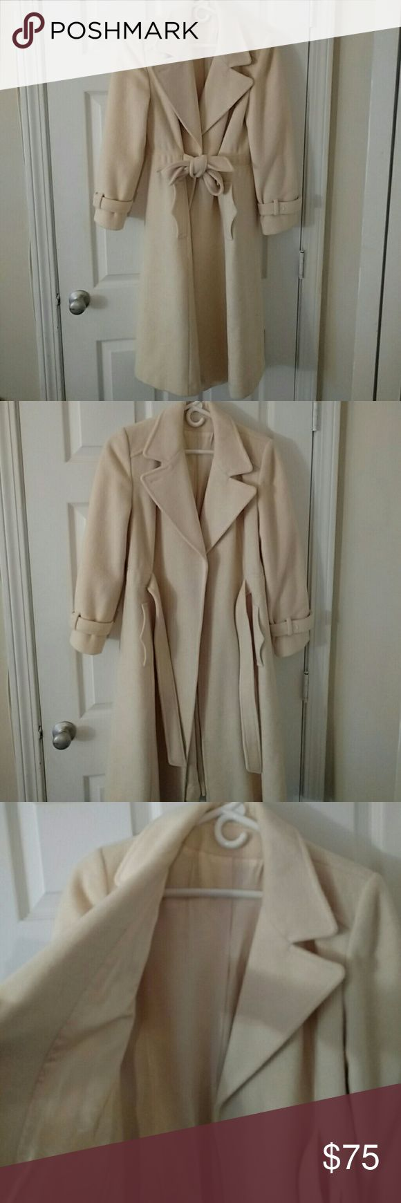 Vintage Wool Creamy Coat Beautiful vintage coat. Long enough for skirts/dresses, tie waist, two side pockets, no buttons. Right now I don't have exact measurements but I can add later. It fits me so I would say best small or medium. I'm 5'7 for length reference in pics. Also the sleeves are a bit short on me but that happens sometimes with vintage. It's 75% wool, 25% nylon. I will have to pay extra shipping on this item so please keep that in mind with your offers. Thank you. Jackets & Coats…